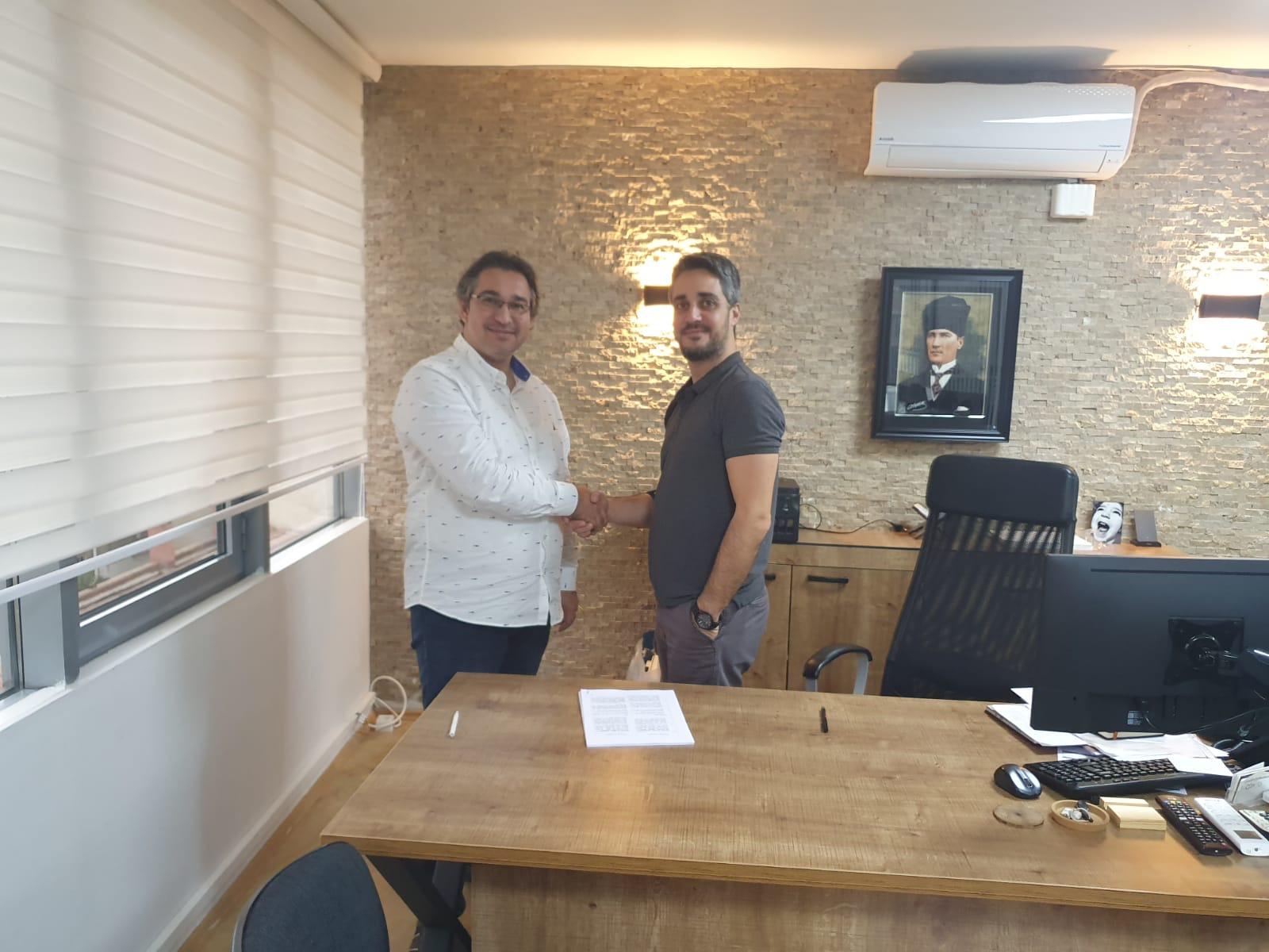 Onur Atacan and Hakan Ertemel shake hands